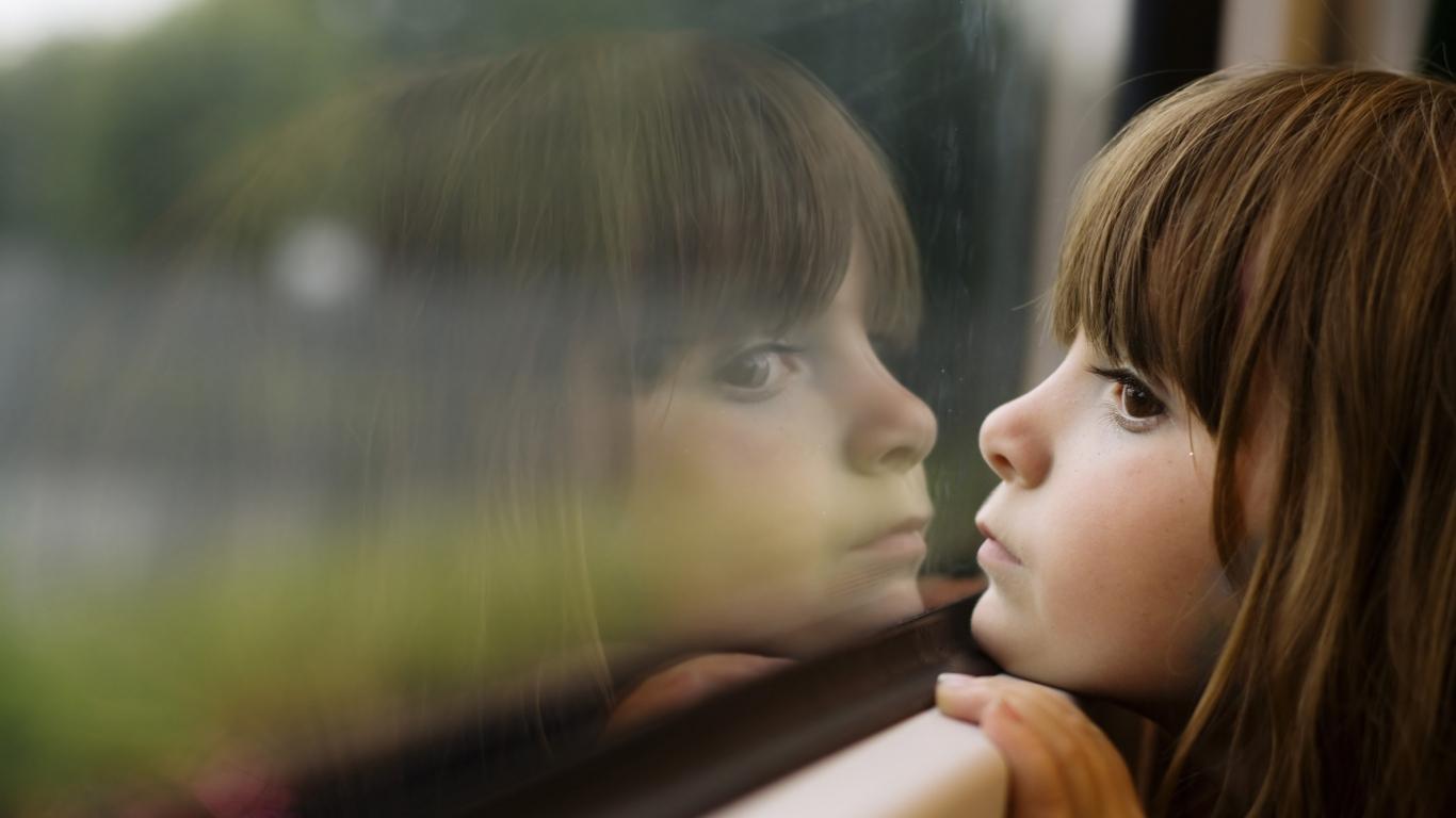 girl_face_sad_brown_window_glass_54552_1366x768
